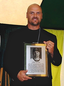 Larry Walker holding Tip O'Neill Award